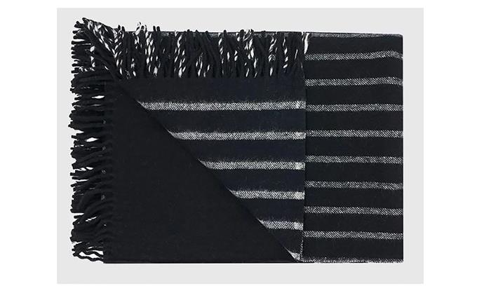 "Lamina Superfine Wool Blanket in black, $325, at [Koskela](https://koskela.com.au/collections/blankets/products/blanket-lamina-superfine-wool-throw-black|target=""_blank""