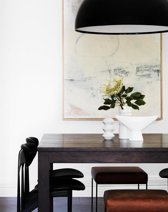 The inclusion of design classics, such as these Featherston 'Scape' dining chairs from Grazia & Co, ensure the home feels contemporary yet timeless. Existing dining table. Lowlife ottomans, MCM House. Flos 'Skygarden' suspension light, Euroluce. Artwork from Saint Cloche