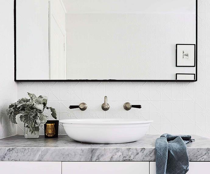 Bathroom vanity with wall mounted taps and marble bench top