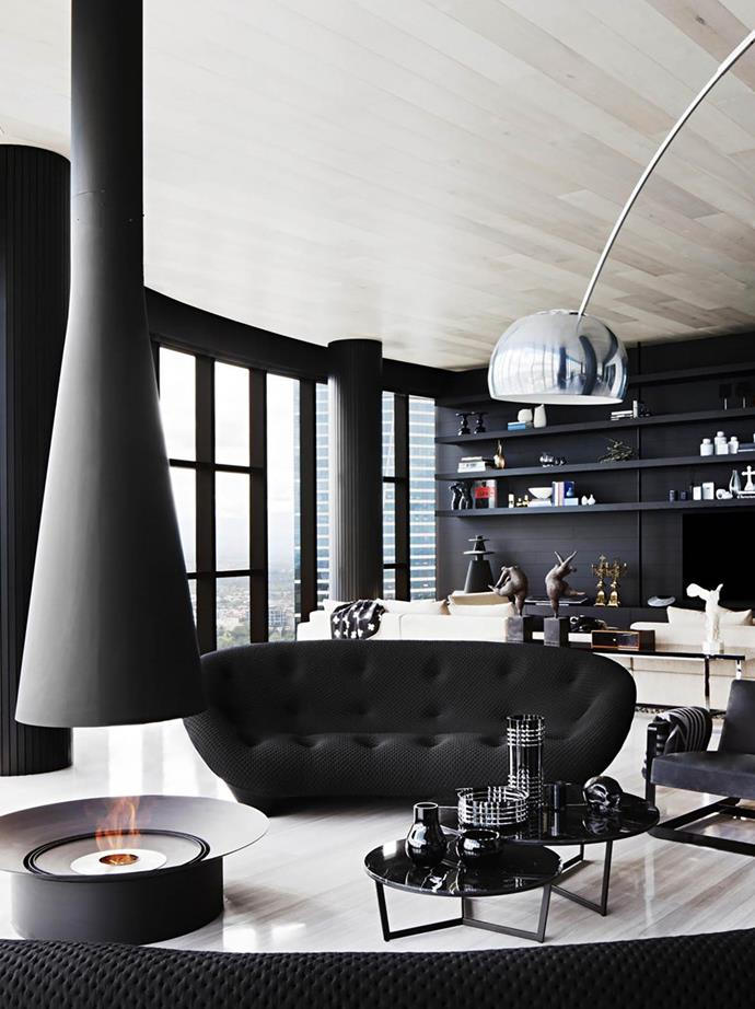 "Fitt de Felice was asked to create a luxurious, stylish and comfortable [family home](https://www.homestolove.com.au/monochromatic-melbourne-penthouse-6455|target=""_blank"") that would also be a great place for entertaining. A Ligne Roset 'Ploum' sofa from Domo acts as a statement piece in the living room."