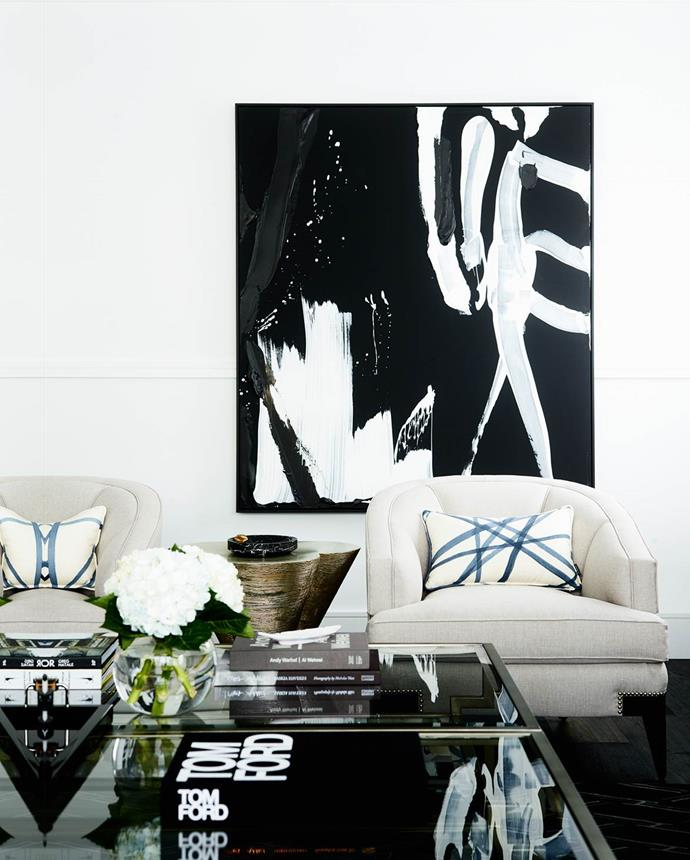 "Designer Greg Natale modified his signature exuberant style to deliver a pared-back aesthetic in this [art deco home](https://www.homestolove.com.au/sydney-art-deco-home-by-interior-designer-greg-natale-4648|target=""_blank""). An artwork by Kerry Armstrong hangs in the family room."