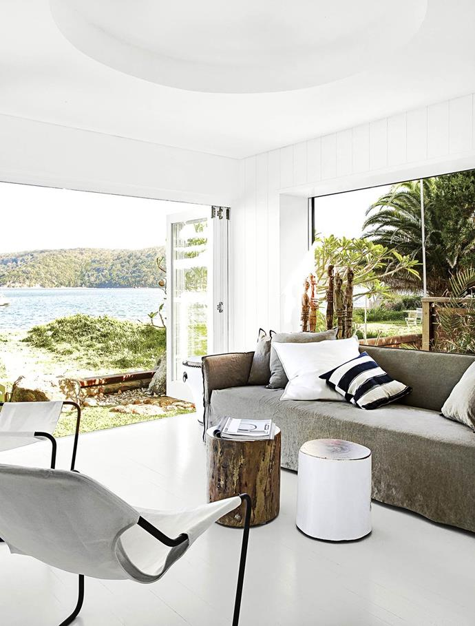 "This [living area](https://www.homestolove.com.au/gallery-a-waterside-family-home-on-sydneys-northern-beaches-1448|target=""_blank"") soaks up views of the water through banks of glass doors and windows. The handiwork of interior stylist Pamela Makin – ""casual, not structured, laid-back and minimal"" – is achieved by layering African tribal elements and inspired re-purposed finds, such as driftwood, shells and bones."
