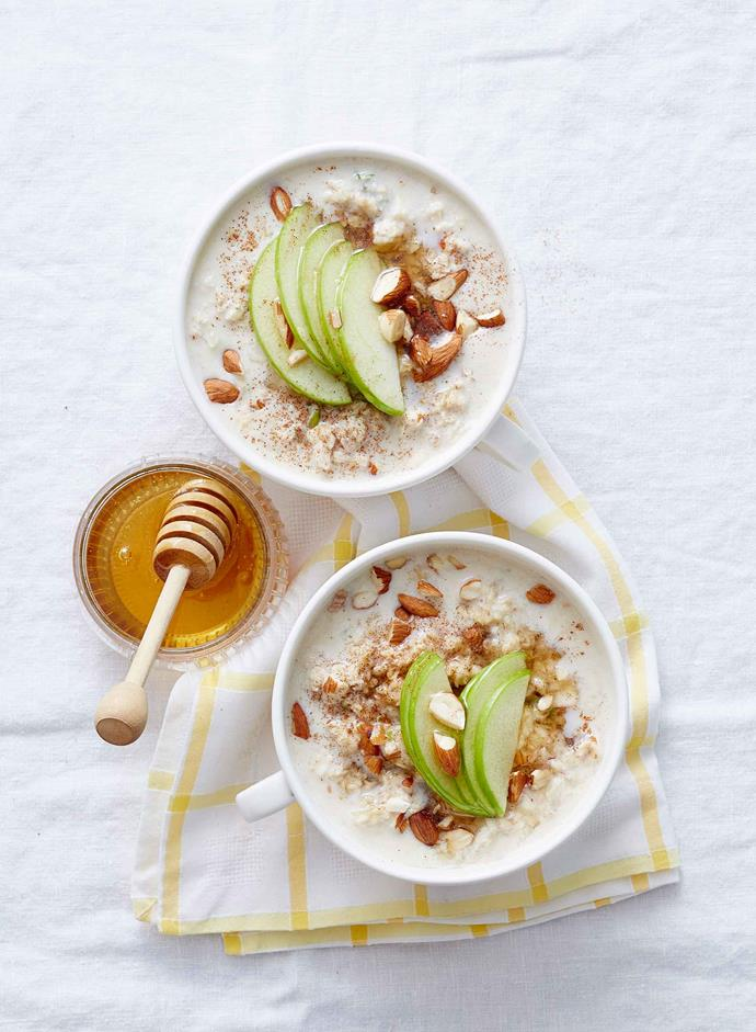 Overnight oats topped with almonds and thin slices of apple.