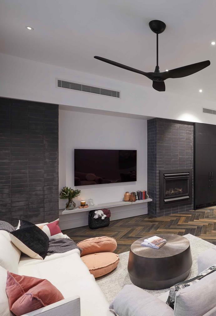 Tess and Luke's living room featured a striking herringbone floor.