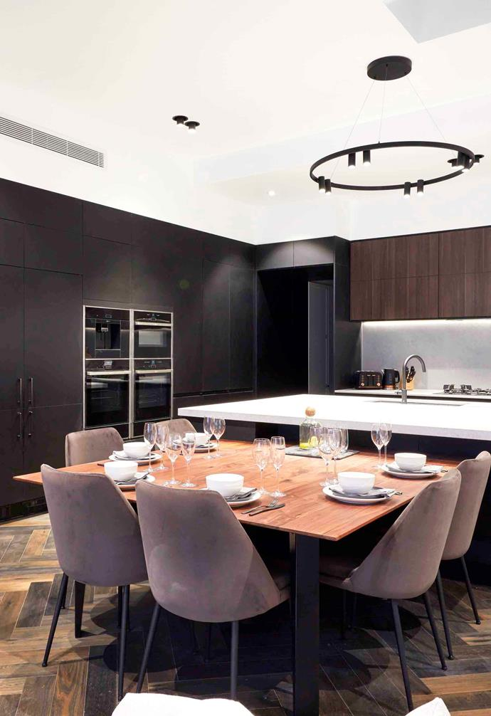 Tess and Luke have chosen a dark and moody palette for their kitchen, living and dining space.