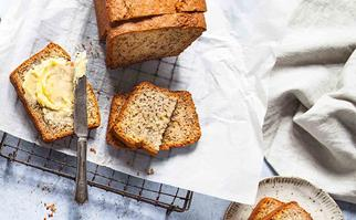 Banana loaf with slices and butter