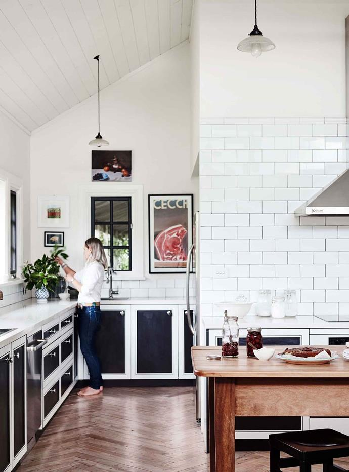 "The kitchen was the biggest splurge for owners Sus and Derek, who wanted the space to be both [timeless and inviting](https://www.homestolove.com.au/rose-farm-cottage-20409|target=""_blank""). The floorboards, laid in a herringbone pattern, were sourced from an old nursing home. Derek restored and laid the floorboards himself."