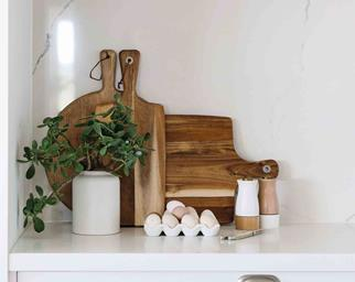 Wooden chopping boards on a kitchen benchtop