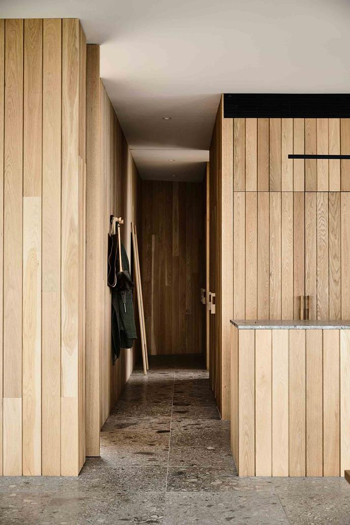 Walls are panelled in American oak, concealing shelving and storage areas for the television, books and other objects.