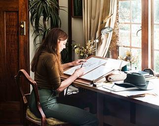 Artist drawing in her studio
