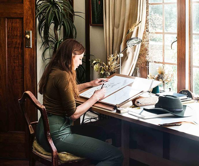 Artist drawing in her studio