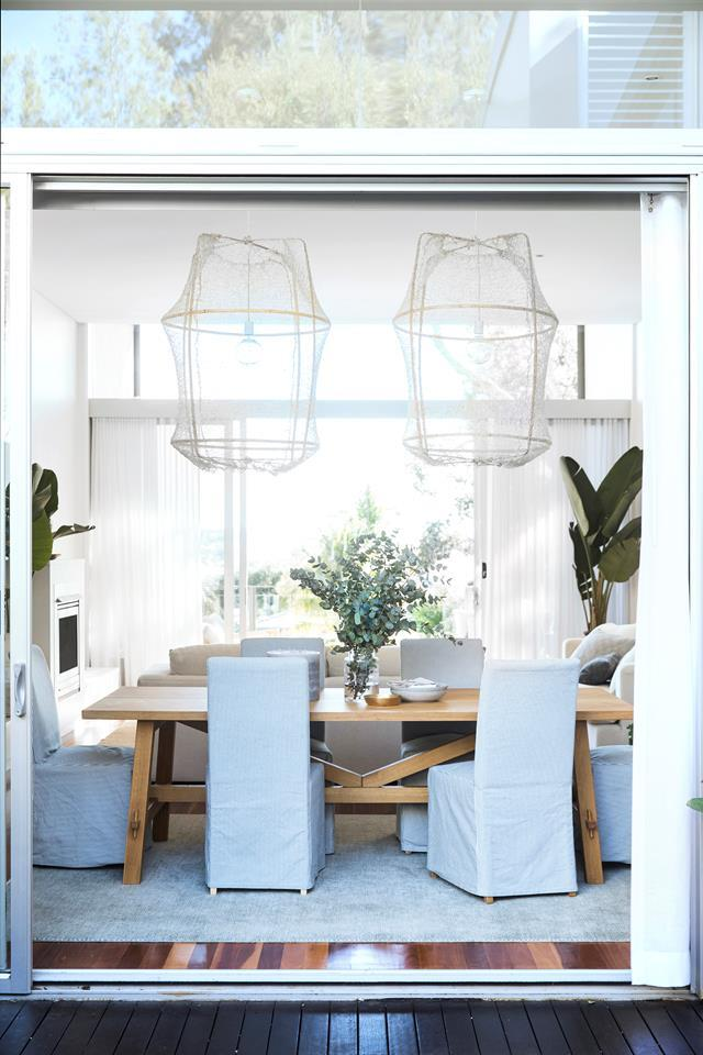 "Well-proportioned furniture was key to achieving overall harmony in this home and choosing larger pieces meant less were required, so Megan Morton played with scale as much as possible. A great example is the choice of large transparent pendant lights for the [dining area](https://www.homestolove.com.au/a-modern-beach-house-with-low-key-luxe-interior-18965|target=""_blank""). Loosely shaped like fishing nets, they draw attention to the table while maintaining a sense of openness."