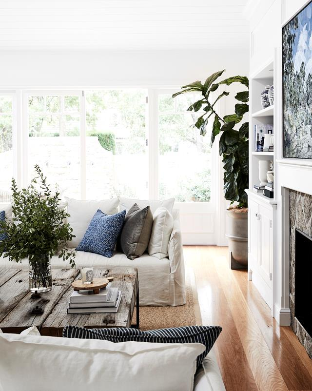 "A farmhouse-meets-coastal aesthetic pervades this single-level [weatherboard home](https://www.homestolove.com.au/family-home-with-character-in-the-nsw-southern-highlands-20547|target=""_blank"") in Sydney's Southern Highlands. a timeless colour scheme, aged timbers and antiques imbue the new home with real character."