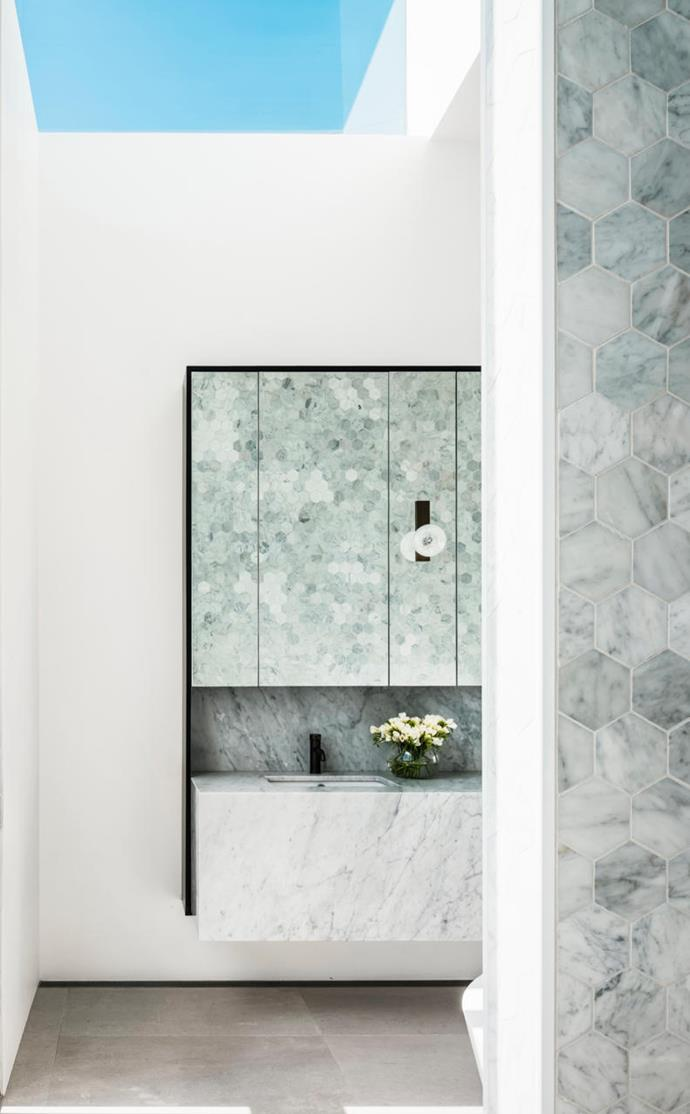 Honed Calacatta marble by WK Stone in the main ensuite is bathed in light from a cleverly positioned skylight.