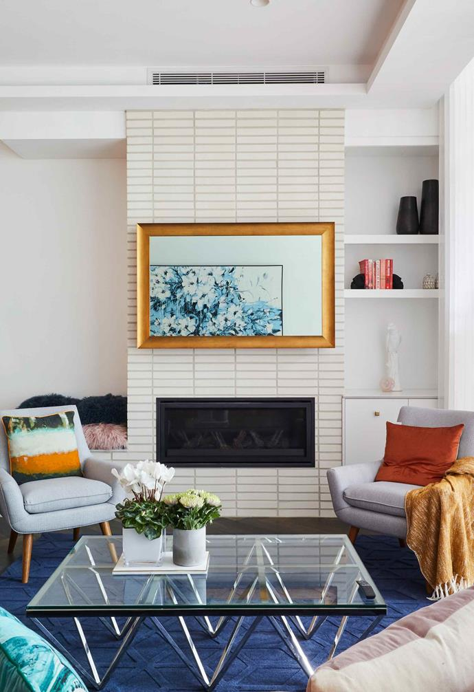 """**Week 8, Living and Dining** Narrow bricks clad the fireplace in Mitch and Mark's [open-plan living space](https://www.homestolove.com.au/the-block-2019-living-and-dining-room-reveals-20694