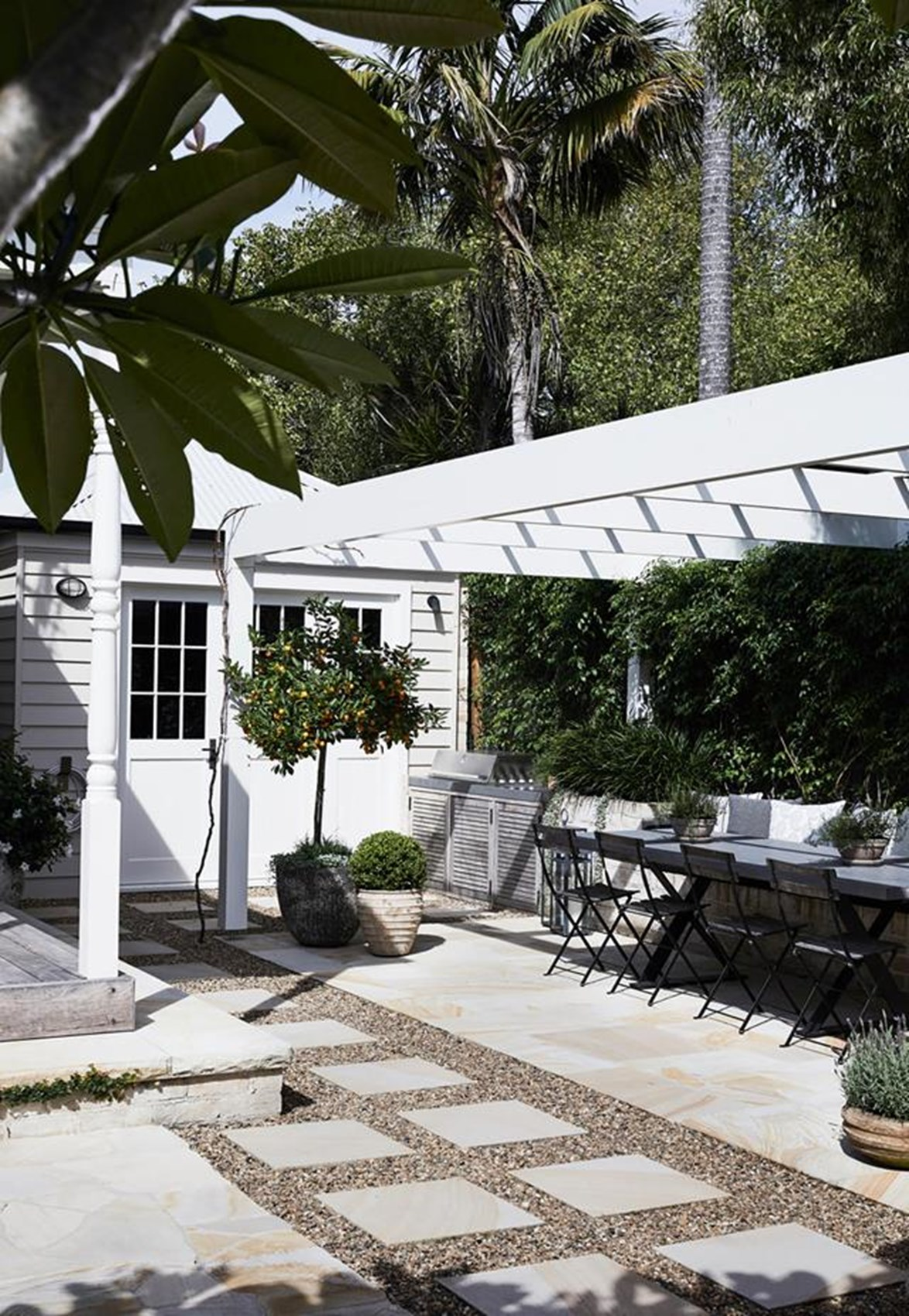 """This charming [weatherboard cottage in Berry](https://www.homestolove.com.au/charming-weatherboard-cottage-in-berry-20329 target=""""_blank""""), NSW, embraces it's country location and makes the most of the space and fresh air. Outside, the custom barbeque enclosure creates an idyllic entertaining zone for the owners who always have friends visiting."""