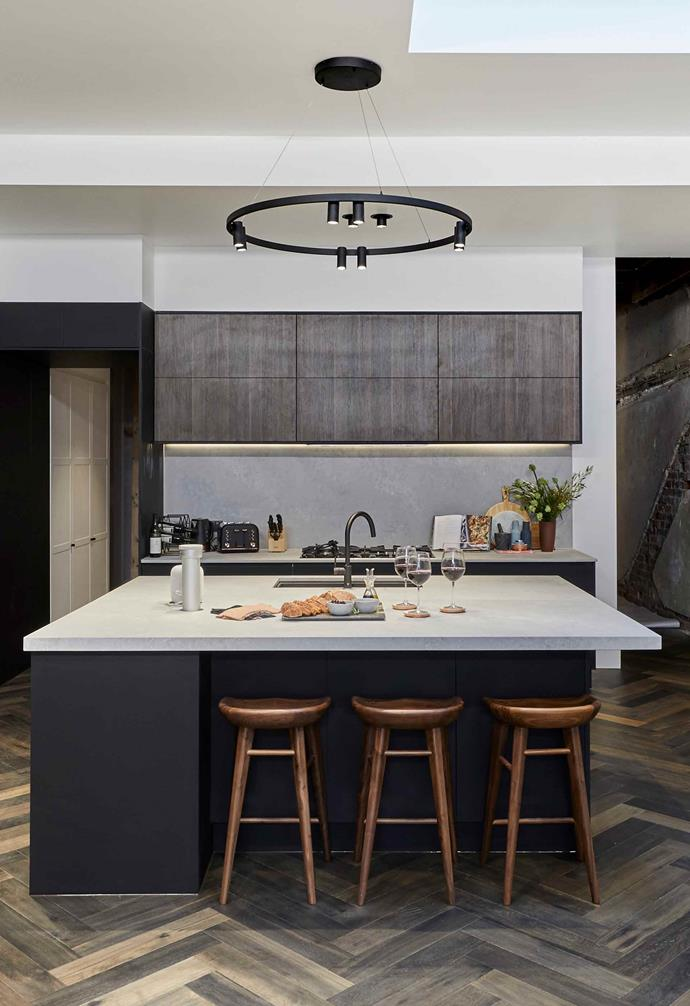 "**Week 7, Kitchen** [Kitchen week](https://www.homestolove.com.au/the-block-2019-kitchen-reveals-20661|target=""_blank"") is one of the important rooms in the home and has evolved into becoming a multi-functional zone for the whole family. Capitalising on this, Tess and Luke opted for a generous concrete-topped island bench paired with dark cabinetry. The judges loved the idea of the main kitchen space, but wished there were a few more stools around the [island bench](https://www.homestolove.com.au/kitchen-inspiration-13-of-the-best-island-benches-17943