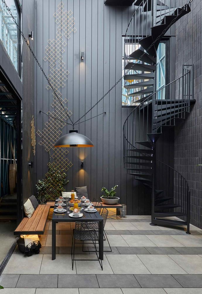 "**Week 9, Courtyard** The hero feature of Tess and Luke's [courtyard space](https://www.homestolove.com.au/the-block-2019-courtyard-room-reveals-20721|target=""_blank"") was undoubtedly the sculptural spiral staircase which accentuated the height of the space."