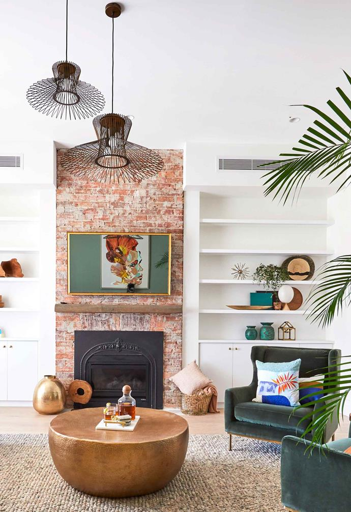 "**Week 2, Formal Lounge** For [formal living room week](https://www.homestolove.com.au/the-block-2019-formal-living-room-reveals-20570|target=""_blank"") Andy and Deb sought to make the fireplace the hero feature of the home, keeping the red-brick intact. The brick creates warm contrast to the white walls and ceilings, as well as the pale blonde timber flooring."