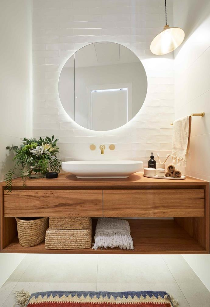 "**Week 4, Main Bathroom** Hoping to replicate their success in the first ensuite reveal with their [main bathroom](https://www.homestolove.com.au/the-block-2019-main-bathroom-reveals-20604|target=""_blank""), Andy and Deb continued their relaxed neutral theme, pairing hand-made tiles with a timber vanity and gold tapware."