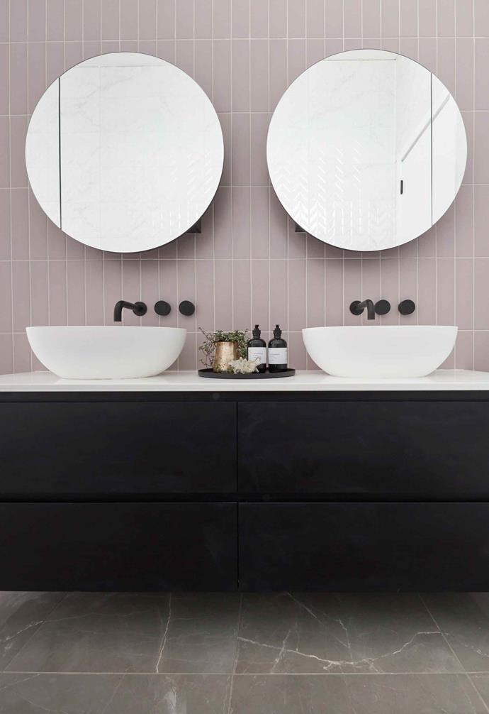 **Week 4, Main Bathroom** This bathroom featured a playful mix of pink subway feature tiles, white textured wall tiles and glossy marbled grey floor tiles. A simple combination of white and black for the basin and vanity finishes the space off.