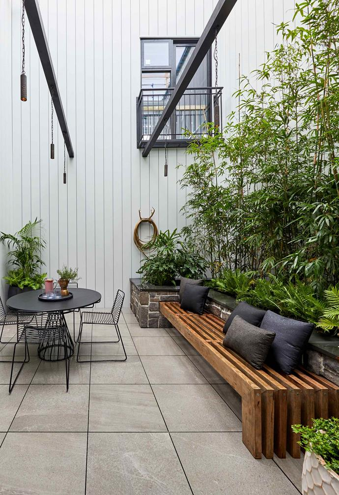 **Week 9, Courtyard** A small outdoor dining set is paired with ample seating from an in-built timber bench.