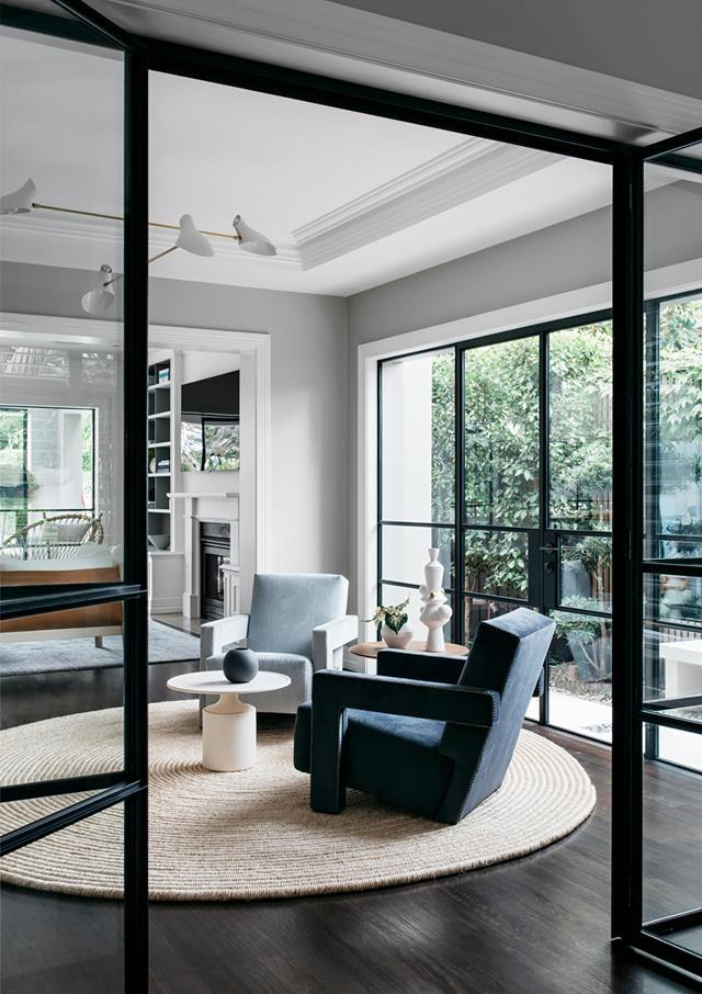 "With the colour palette dialled to neutral and a less formal aesthetic, this [Sydney house](https://www.homestolove.com.au/functional-and-elegant-home-by-arent-and-pyke-20352|target=""_blank"") has a new lease on life. The former formal dining area has been reinvented as a music room, furnished simply with two Cassina 'Utrecht' armchairs from Space in differing shades of blue."