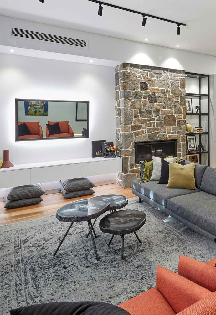 **Week 8, Living and Dining** A stone clad fireplace was the hero feature of the open-plan living and dining space, with the judges remarking that it felt like a ski lodge.