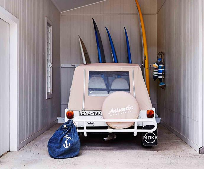 Pink beach buggy in a garage with surfboards