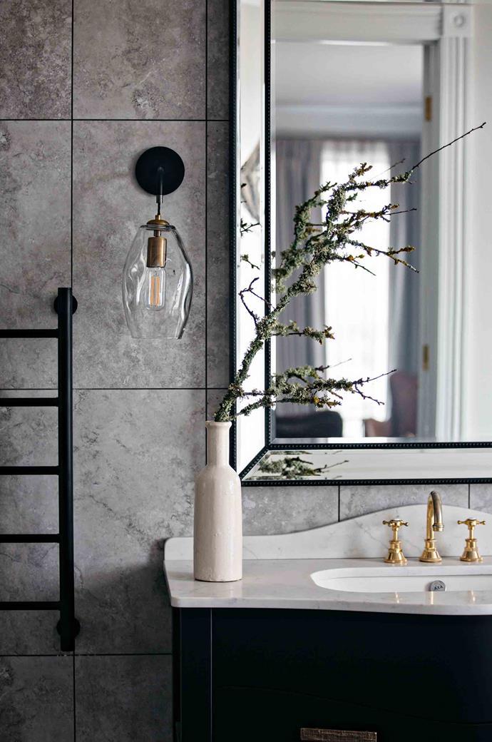A marble vanity in an ensuite bathroom.