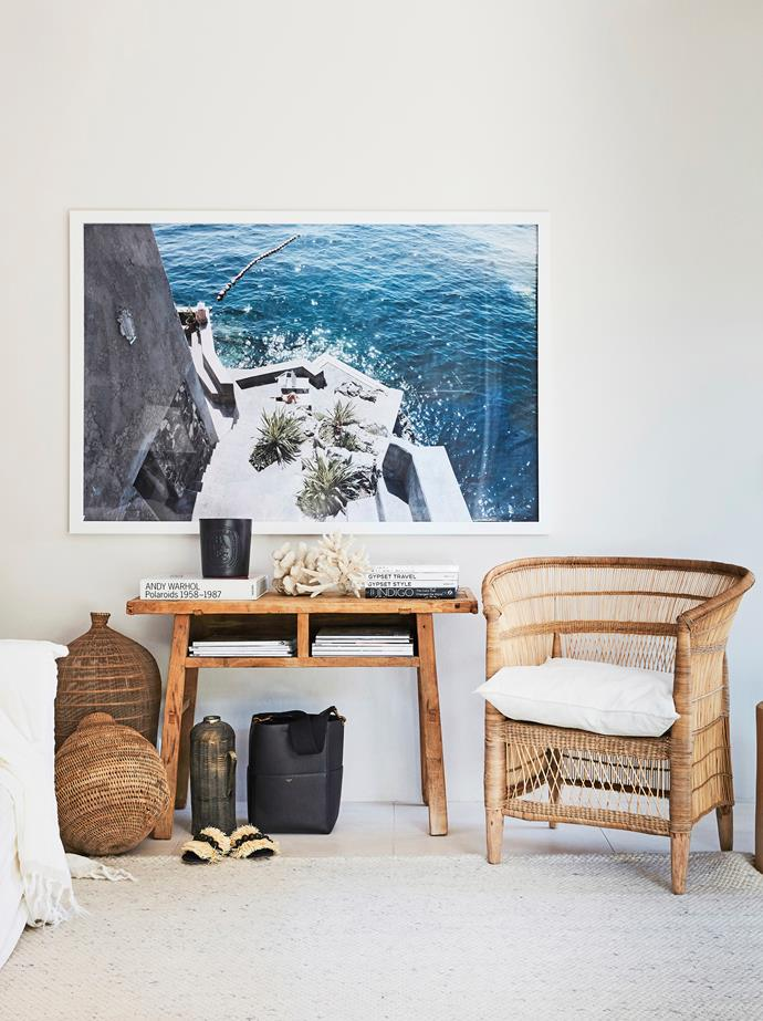 In a room decorated with a mix of neutral and honey hues, the eye is instantly drawn to a mesmerising blue photographic print.