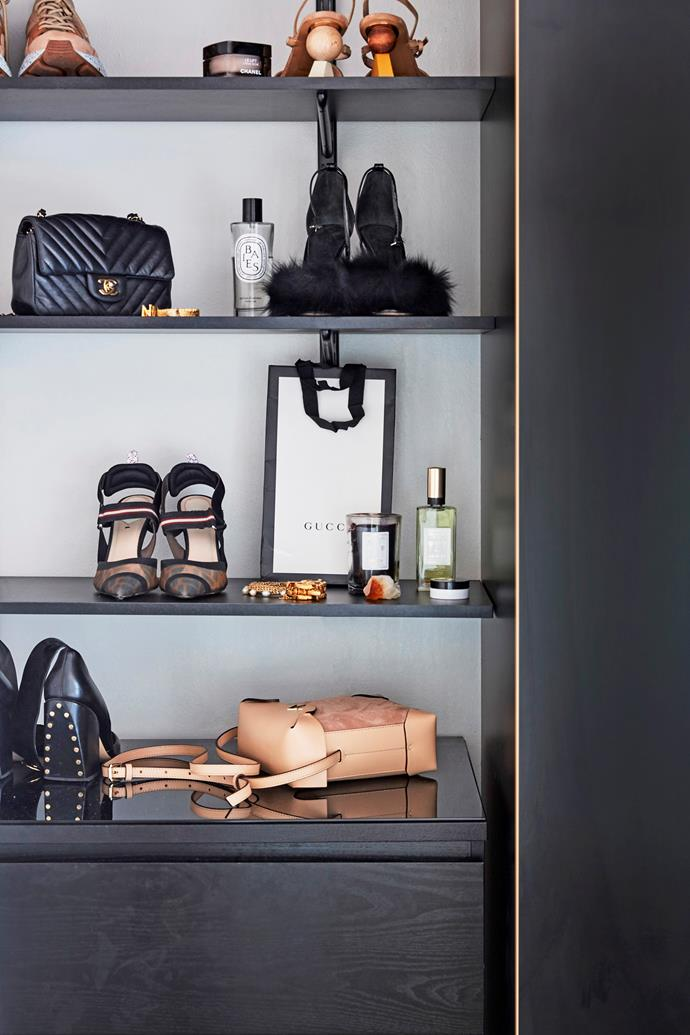 These black shelves display Nikki and Sophie's designer wares elegantly. Painting your shelves is a great way to add a statement colour without having to give up the white scheme you love.