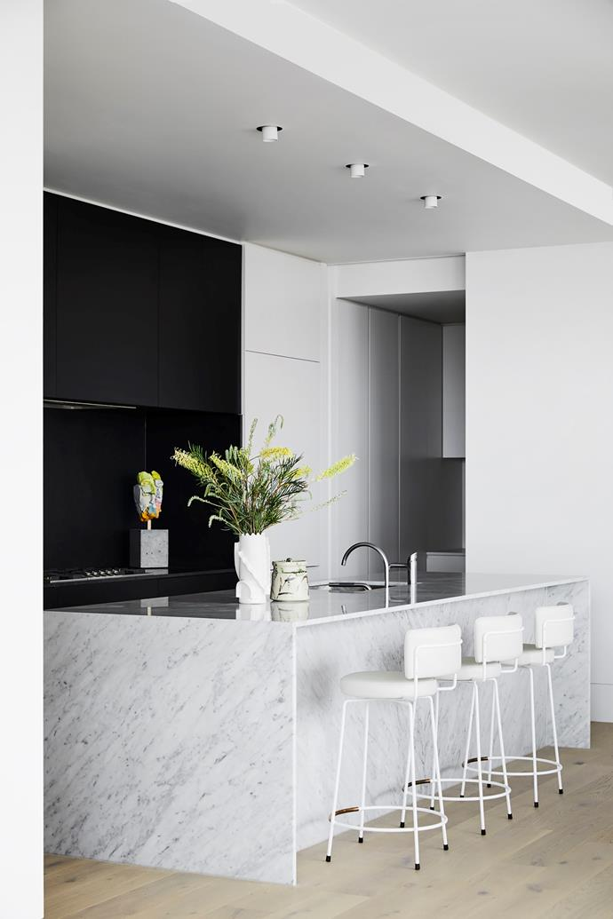 Curves in the Moooi pendant from Space and Dita stools from Grazia&Co help soften the kitchen's look.