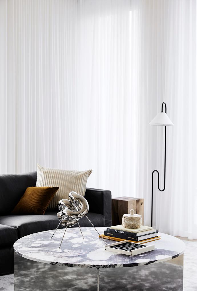 Textural cushions and a Leila charcoal sofa from Jardan create a luxe yet inviting look.