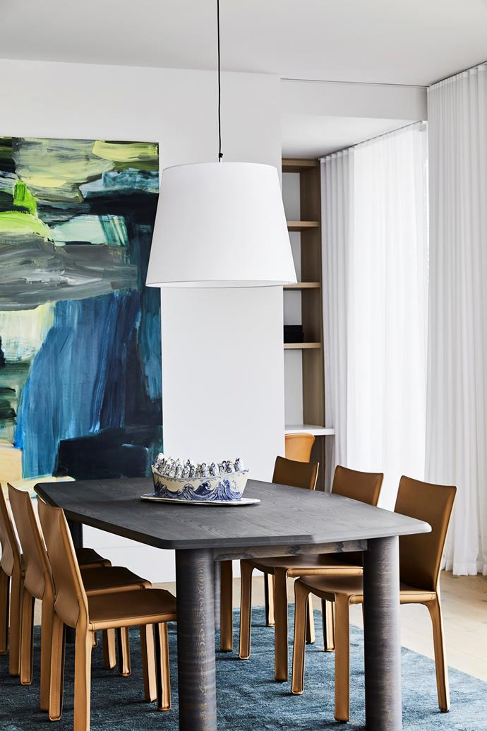 Cassina 'Cab' chairs from Space work well with an Arte stained oak table from Jardan. A painterly artwork by Penny Coss adds a bold jolt of colour.