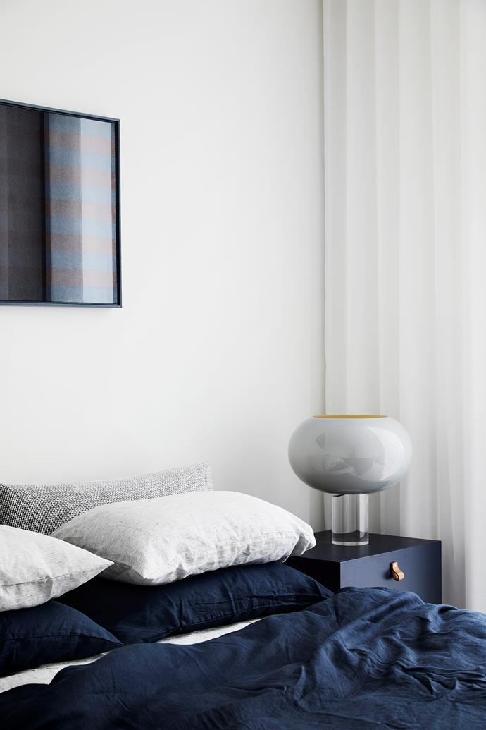 Textural inky blue linen from Bed Threads sets a moody and relaxed vibe in the bedroom.