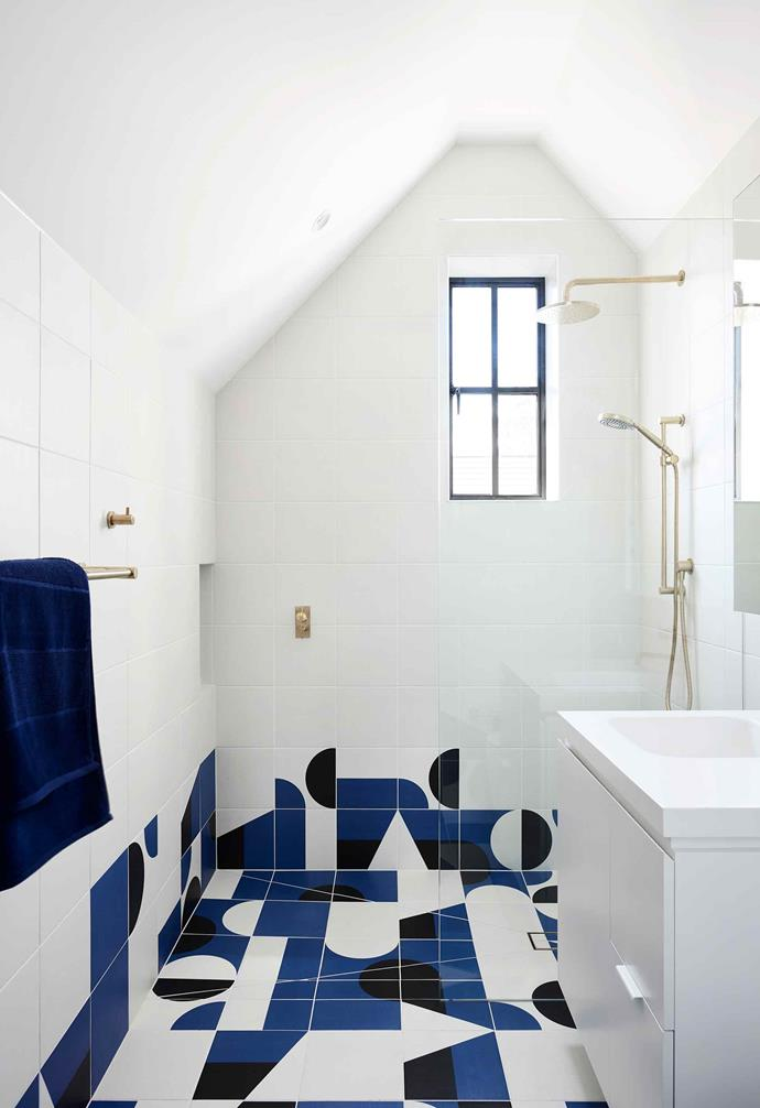 **Blue wing** Creeping up the wall of the ensuite are Mutina 'Puzzle' floor tiles from Urban Edge Ceramics.