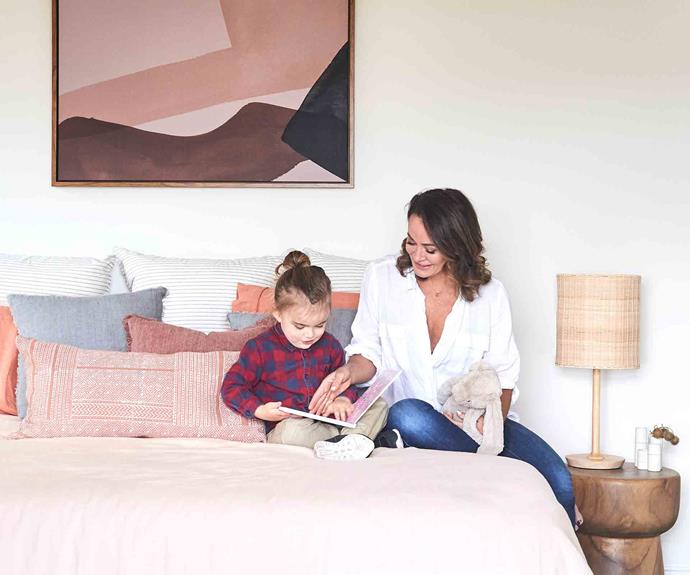 "Reading with Axel. The master bedroom takes colour cues from an abstract artwork. ""I had no idea how good [linen sheets](https://www.homestolove.com.au/how-to-take-care-of-linen-sheets-3223
