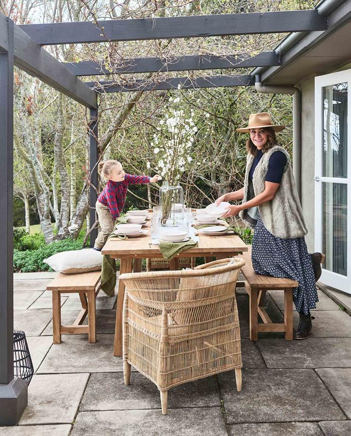 "Michelle setting the outdoor table with son, Axel. The [teak dining table](https://fave.co/2OUsmNq|target=""_blank""