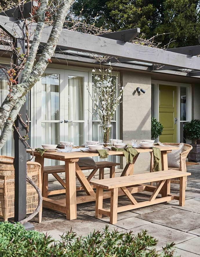 "The outdoor dining space is ""one of the best parts of our home,"" says Michelle, who asked Jackie to channel a ""relaxing vibe that doesn't look overly styled."""
