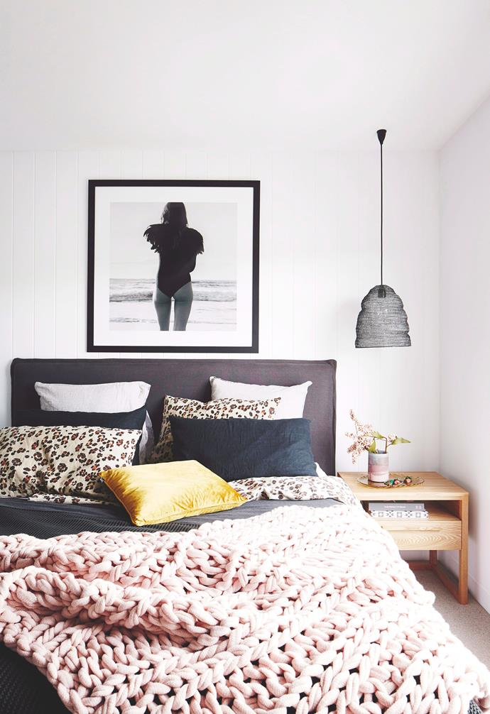 """The grey bedhead in the bedroom of this [coastal townhouse](https://www.homestolove.com.au/coastal-holiday-home-19311