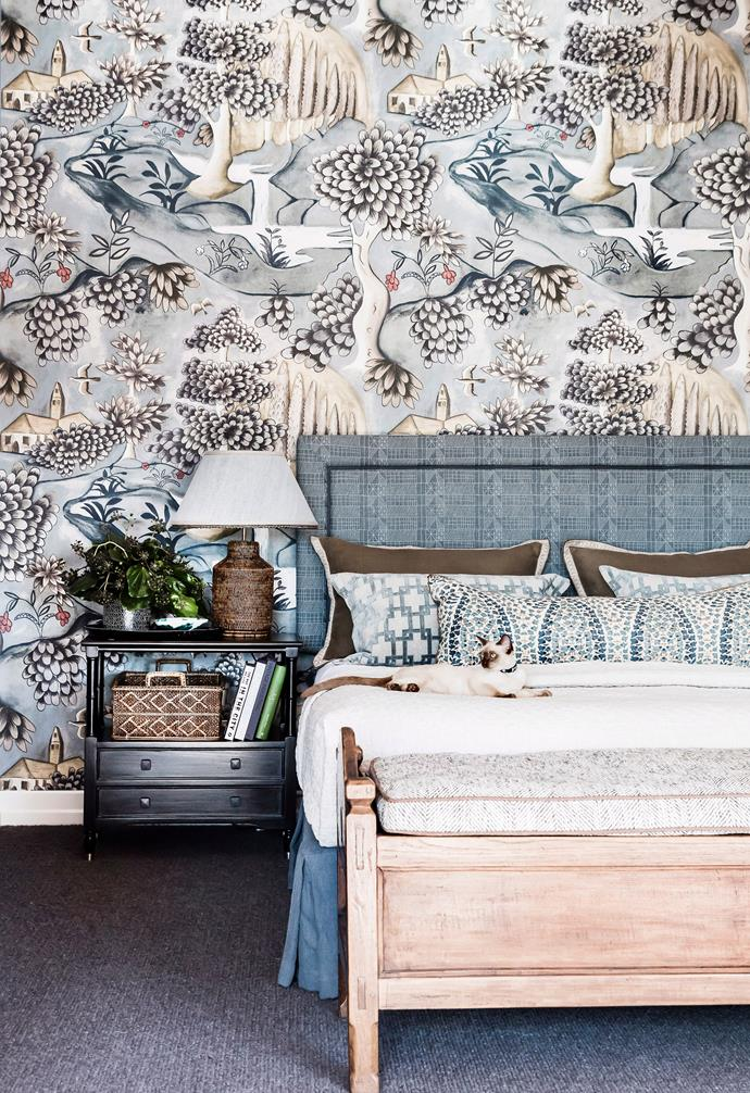 In this bedroom a simple upholstered bedhead takes its colour cues from the statement wallpaper behind it.