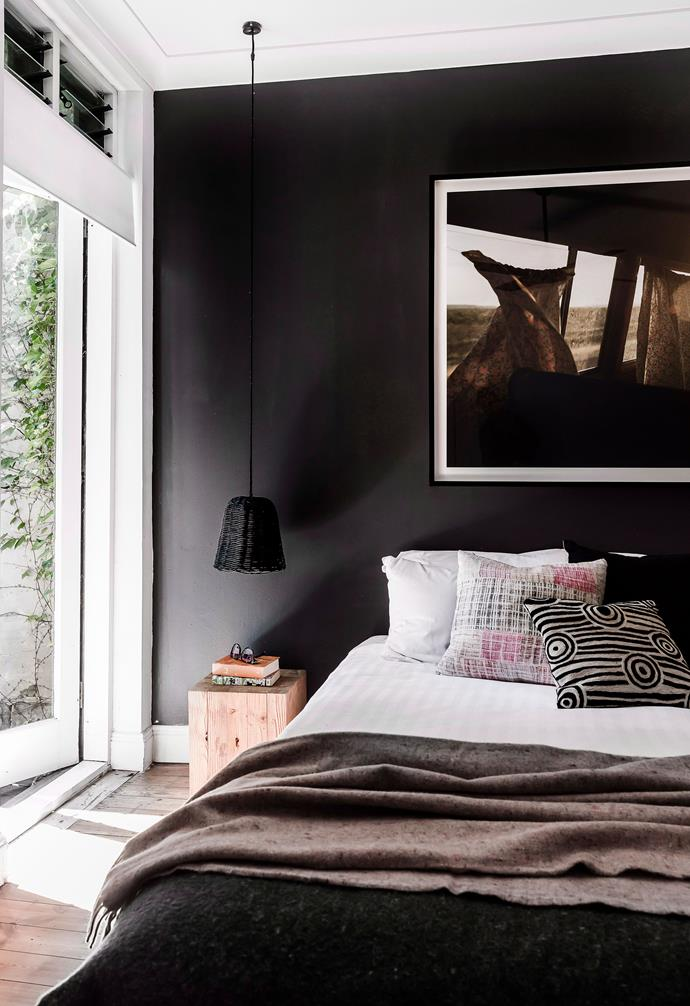 If you're short on space, try hanging a statement artwork above your bed for a similar effect.