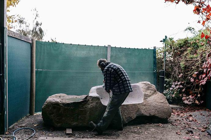 Here he has made a start in creating a seat from stone.