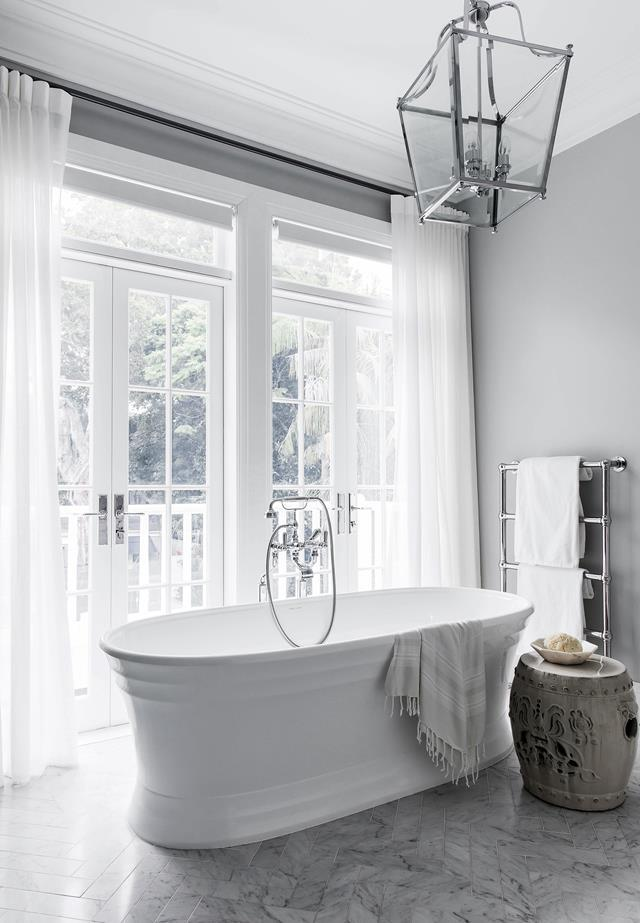 "An [elegant bathroom](https://www.homestolove.com.au/a-luxurious-hamptons-style-home-in-sydneys-eastern-suburbs-6074|target=""_blank"") conceived by Coco Republic makes for the perfect spot for a luxurious soak."