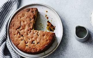 Pumpkin fruitcake with a slice missing