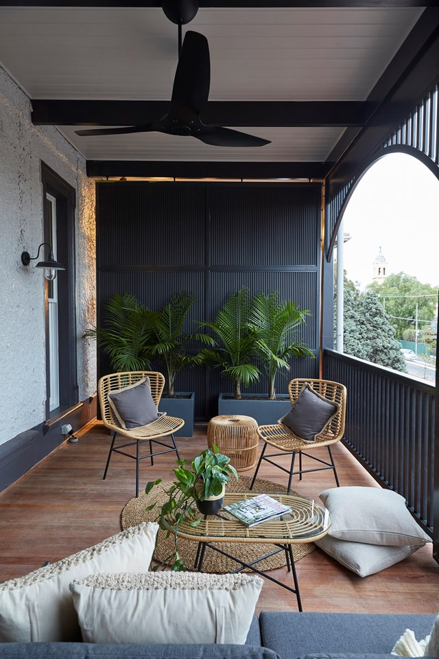 **Week 11, Verandahs** Andy and Deb ditched their preferred neutral palette in favour of charcoal tones and black furniture to complement the colour of the façade. The judges were disappointed they didn't stick to their style by including a crochet hammock and some colour.