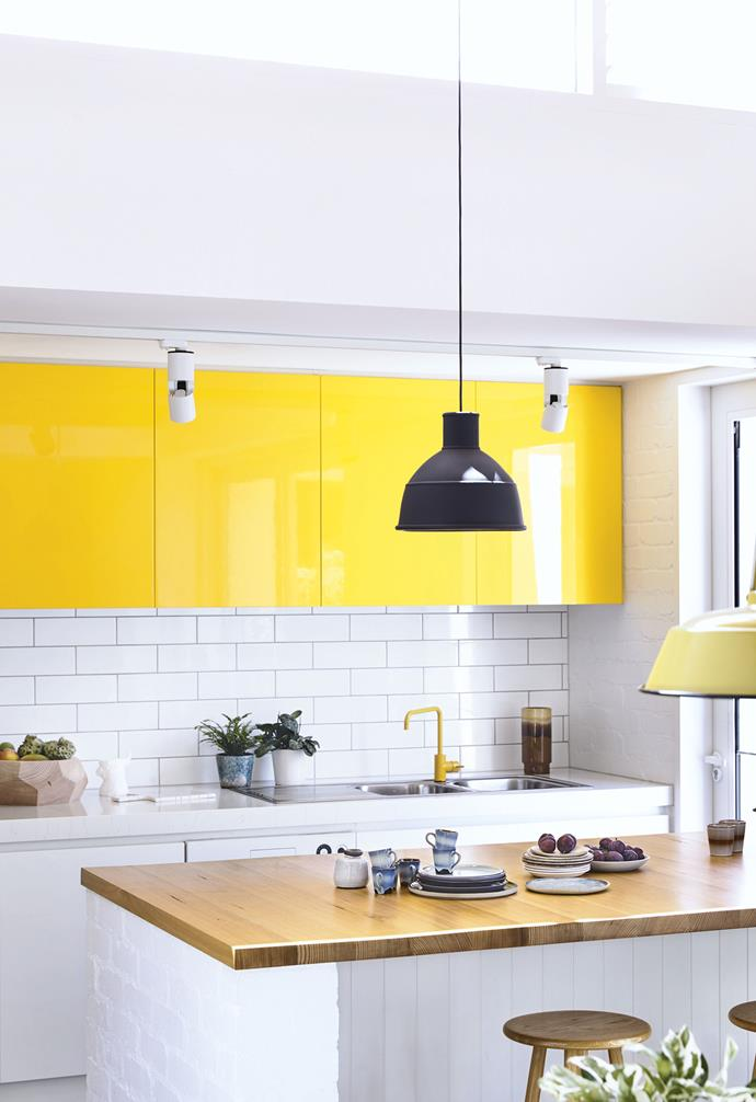 """In addition to maximising space, Derek and Georgia wanted big windows, a modern kitchen, a lot of white brick and better zoning. <br><br>The existing front door was screened off and a new entry established at the side so it was no longer necessary to walk past the bedrooms to access the living areas.<br><br>**Kitchen** Sunny yellow gloss cabinets are matched by the [Astra Walker](https://www.astrawalker.com.au/