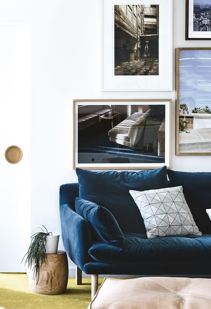 """Conscious of not disrupting the existing roofline, Rachel designed a split level so that the new extension sat lower than the ground-floor living area. Lined in warm cedar, the soaring kitchen ceiling adds drama but also welcomes in sunlight.<br><br>**Living area** A rich electric blue 'Andy' velvet sofa is teamed with a leather ottoman and a plush peach armchair, all from [Jardan](https://www.jardan.com.au/