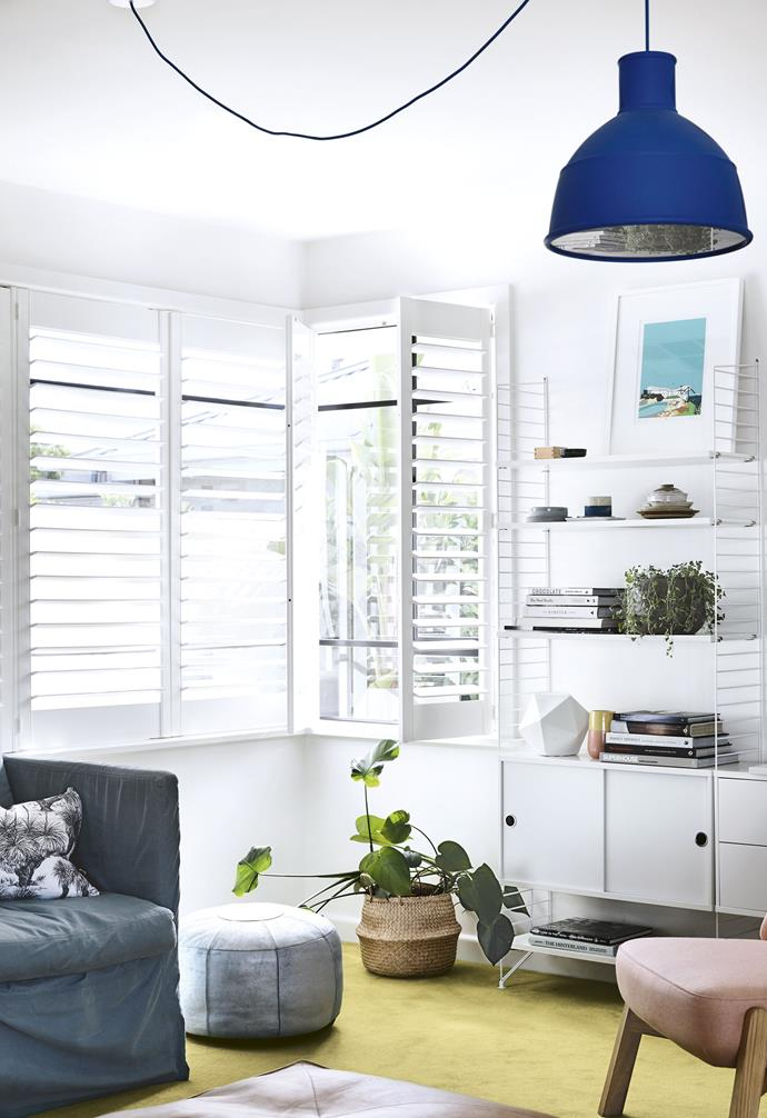 """While the kitchen and dining area has a [Scandi look](https://www.homestolove.com.au/scandinavian-style-homes-19651